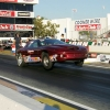 nhra-winternationals-wheelstanding-doorslammers-2012-024