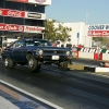 nhra-winternationals-wheelstanding-doorslammers-2012-027