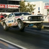 nhra-winternationals-wheelstanding-doorslammers-2012-036