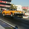 nhra-winternationals-wheelstanding-doorslammers-2012-043