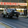 nhra-winternationals-wheelstanding-doorslammers-2012-056