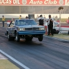 nhra-winternationals-wheelstanding-doorslammers-2012-057