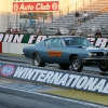 nhra-winternationals-wheelstanding-doorslammers-2012-078