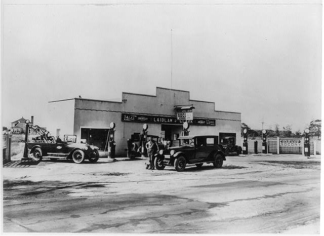 Ancient car dealership - check out the tow truck