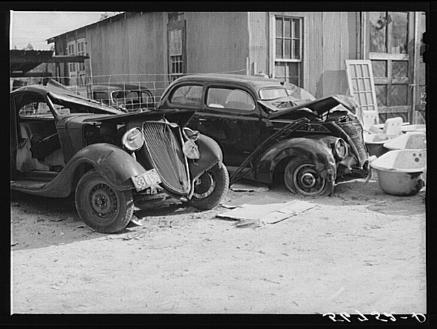 Another angle of the wrecked car and truck