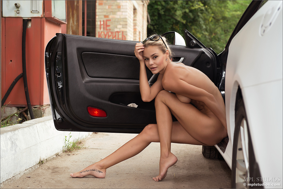 Ladies posing with cars .. Can we if we don't get ...