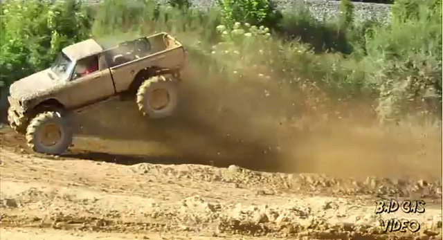 Watch a Wild Tractor Tired Chevy LUV Truck Catch Huge Air and Slog Through Mud Bog Pits!
