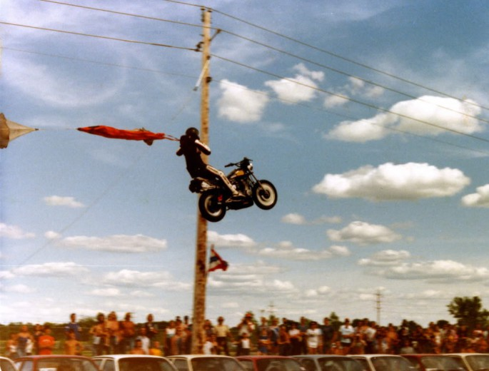 Historic Motorcycle Jump Fail Caught on Film – Jumping John Holland's Failed Leap Over 50 Chevettes