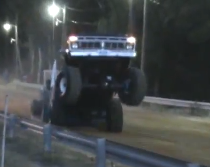 Video Bonanza: Huge Ford Trucks Carrying Huge Wheelies On The Pulling Course And Slogging Through The Mud Pit