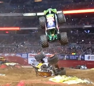 Incredible Video: Watch The Grave Digger Monster Truck Leap and Land Directly On The Turtled Maximum Destruction Truck and Then Jump Over It!