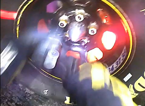 Watch A NASCAR Crew Guy Change A Tire While The Rotor Literally Bursts Into Flames – Helmet Cam View