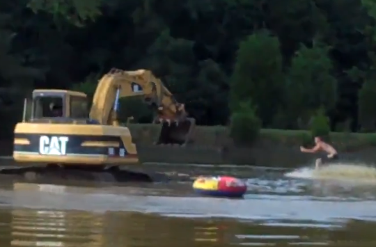Hilarious Video: Watch A Dude Go Water Skiing With An Excavator For Propulsion – Big Time Fun!