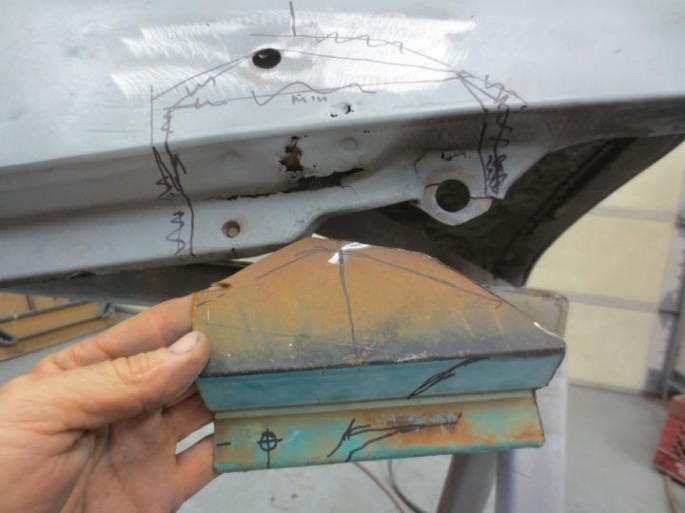 """""""...fixing another rust hole. I had a sort of replacement panel, it has the right contour for part of it, but not the area with the mounting hole, I had to make that shape. I did lots of hammering and bending and heating, and got it pretty close."""""""