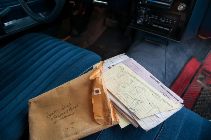 Opening the glove box revealed a surprise in the form of several pounds of vehicle documentation from the original owner of the vehicle.