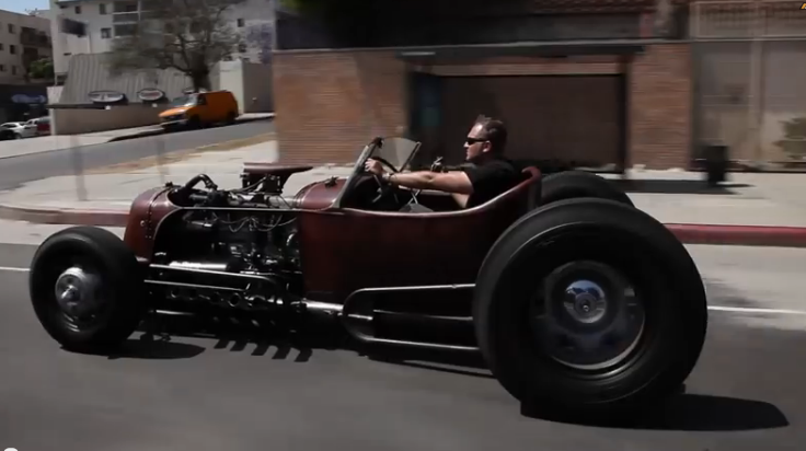 This 1931 Ford Is Powered By An Old Diamond Rio Truck Motor and Has A Frame Made Of Old Light Poles – We Dig (Video)
