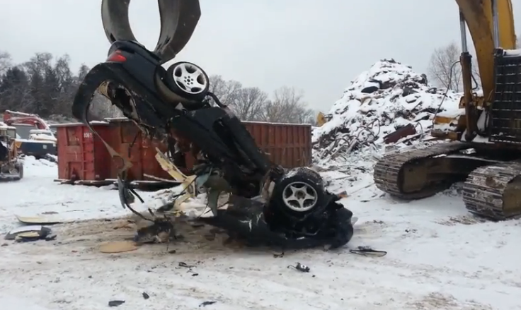 Best Of 2014: Watch A Dodge Viper Get Completely Destroyed By A Huge Junkyard Excavator!
