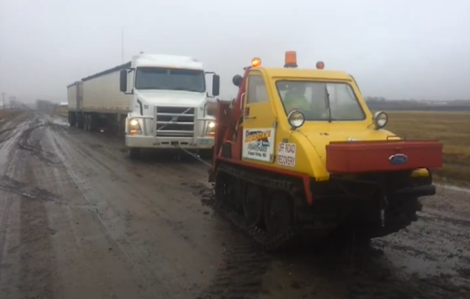 This Video Of A Bombardier Sidewalk Plow Pulling A Big Rig Out Of The Mud Is Totally Awesome