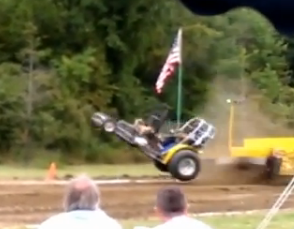 Pulling Tractor Launch Off Ground