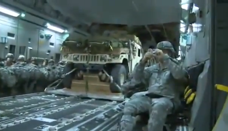 Watch Four Humvee Trucks Get Sucked Out The Back Of A Cargo Plane With Parachutes – Very Cool Stuff