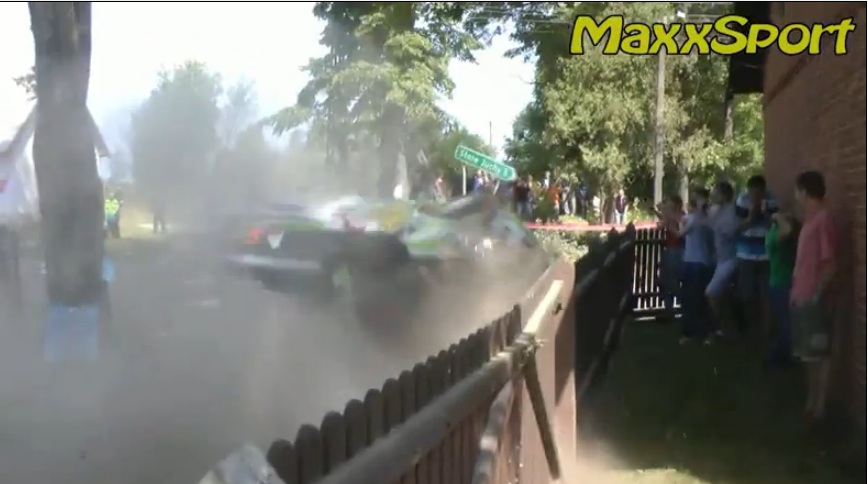 Watch A WRC Rally Car Nearly Wipe Out A Group Of Kids Watching Inside A Picket Fence Pen