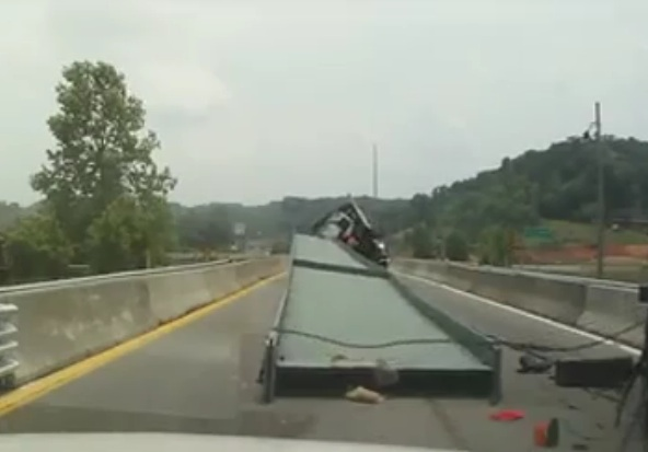 Watch A Trucker Hauling A Massive Steel Beam Miscalculate A Corner And The Disaster That Follows His Tiny Mistake