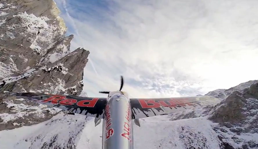 Take An Awesome Ride In The Austrian Alps On The Wings Of A Red Bull Stunt Plane – Take Off On A Highway