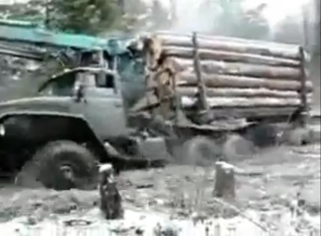 Watch This Huge Russian Truck Pull A Load Of Logs Out Of The Woods And Through The Muck Like A Mechanical Mule