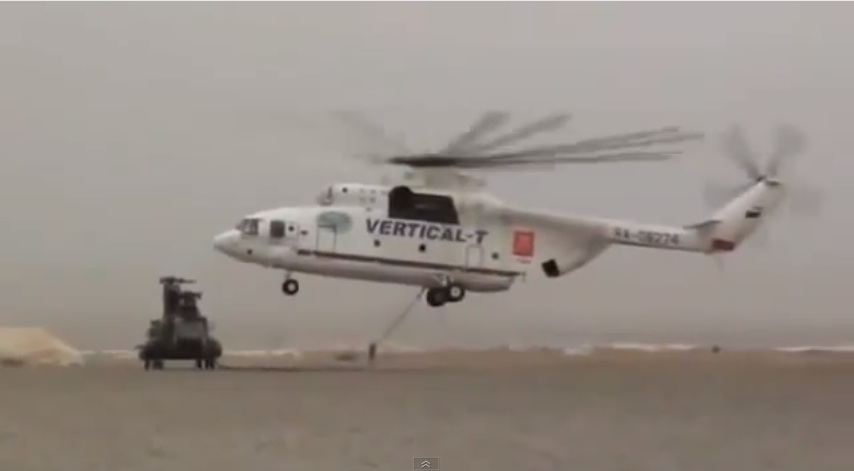 Watch a Mi-26 Sling-load A Chinook Helicopter Like It's A Toy