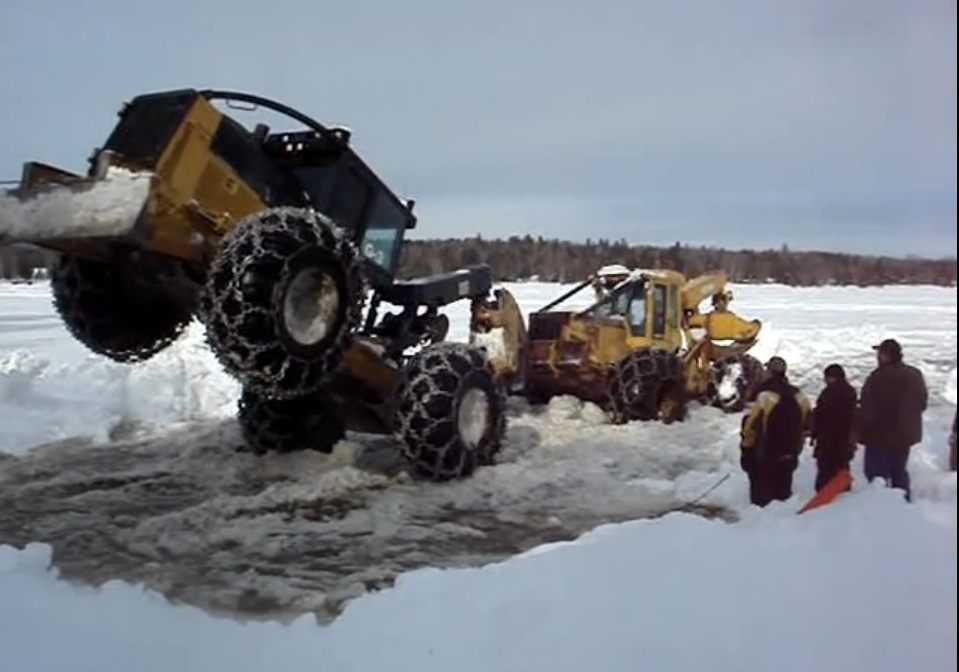 Leverage And Torque Rule: Watch This Log Skidder Operator Save Another Machine From A Frozen Lake In Maine