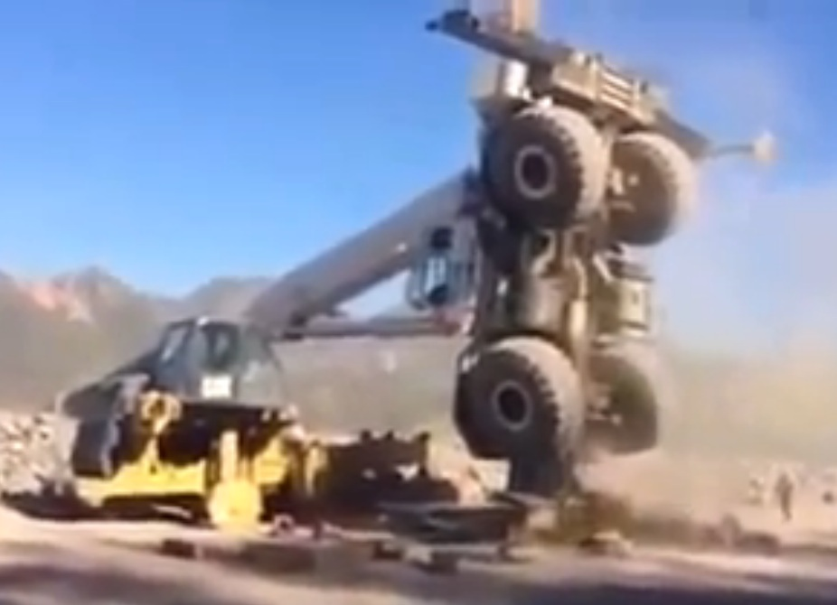 Epic Safety Fail Video: Watch These Workers Narrowly Escape Death When A Crane Fails While Holding A Massive Heavy Haul Truck