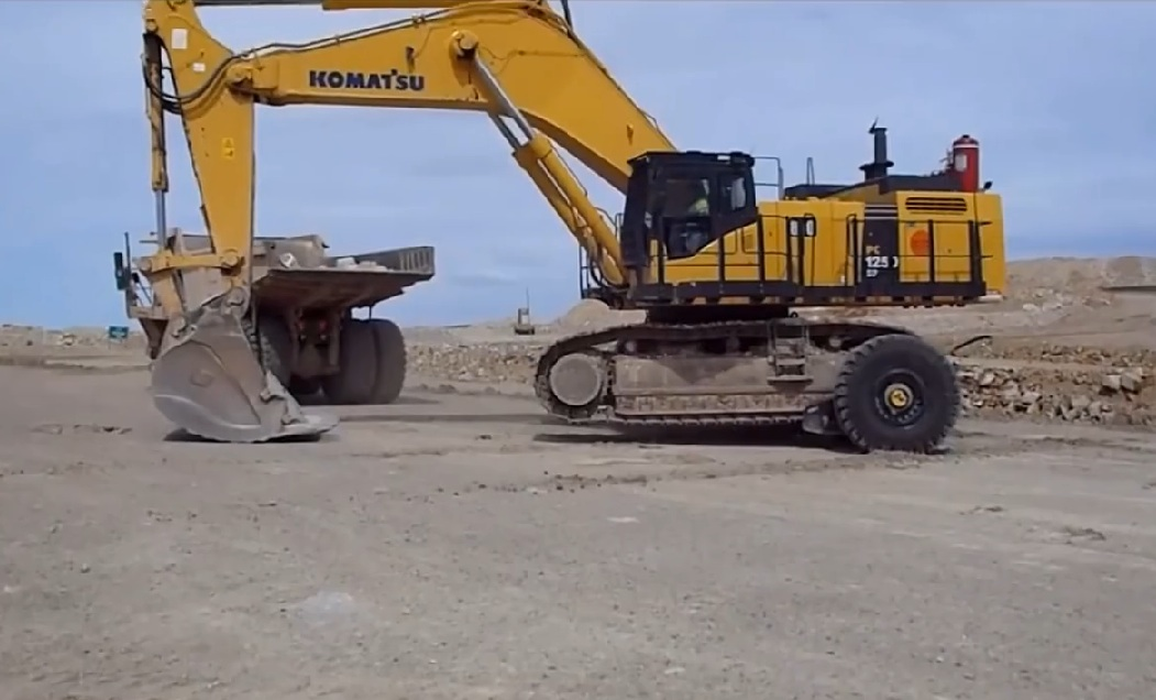 This Is The Simplest, Fastest, And Most Brilliant Way To Move An Excavator Around A Huge Mine – BangShift Approved