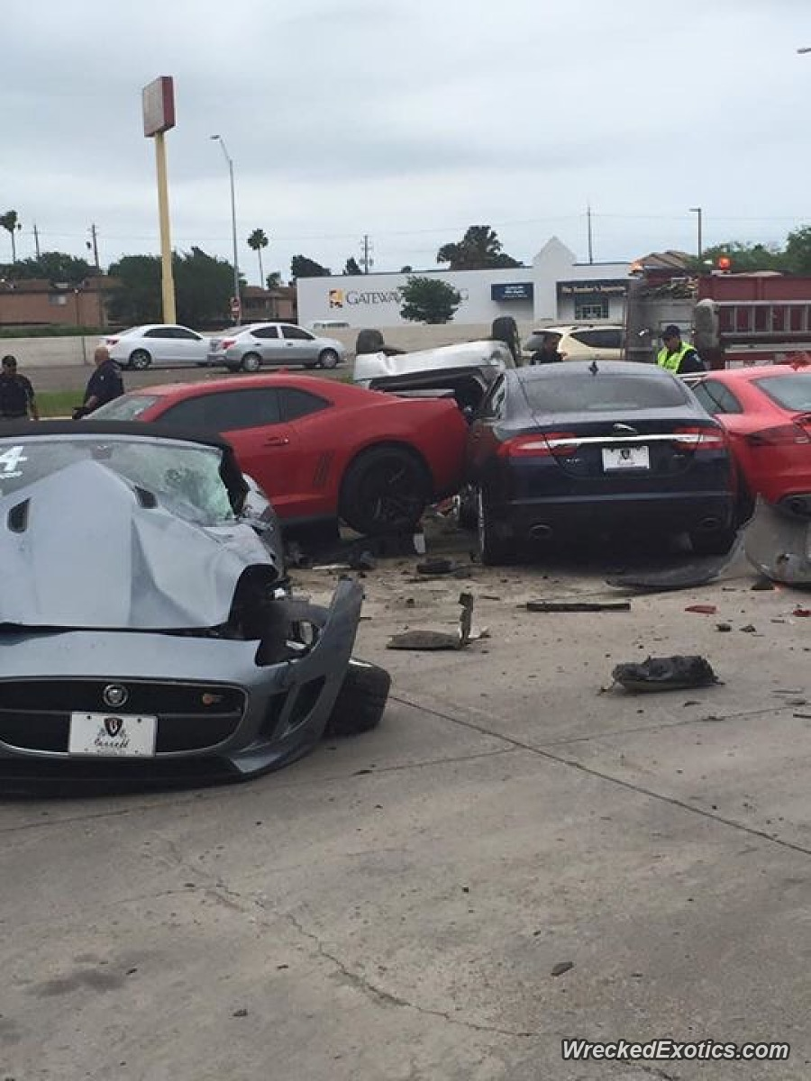 What Are The Odds? Car Loses Control Leaving An Expressway, Takes Out Cars Parked At A Jaguar Dealership