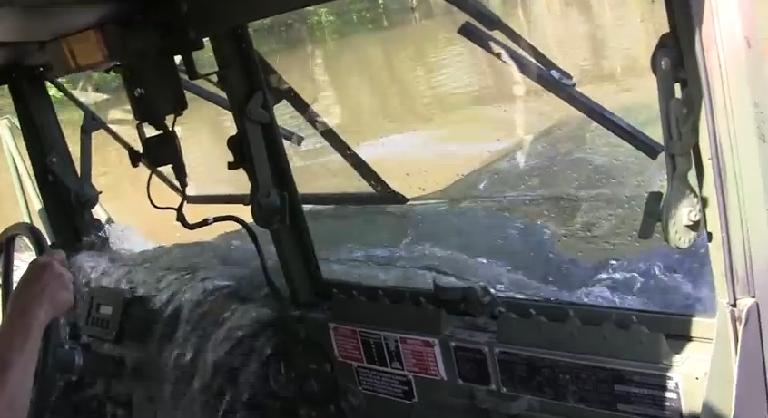 Watch This Huge Deuce And A Half Truck Drive Through What Looks Like A 6ft Deep Swamp…With A Twist