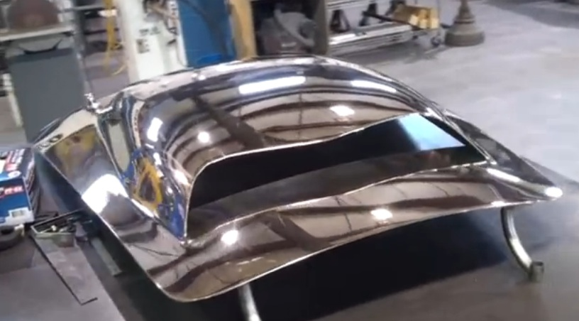 Watch The Guys At Kirkham Motorsports Hand Form A Cobra Hood…Out Of Bronze