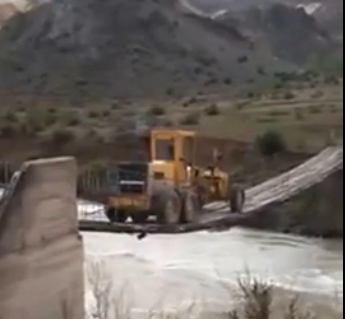 Would You Have The Guts To Drive A 34,000lb Road Grader Over The Most Rickety Looking Bridge Known To Man?