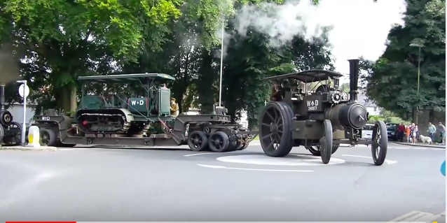 Watch This Steam Tractor Pull A Lowboy Trailer With A Crawler Tractor On It Through An Intersection!