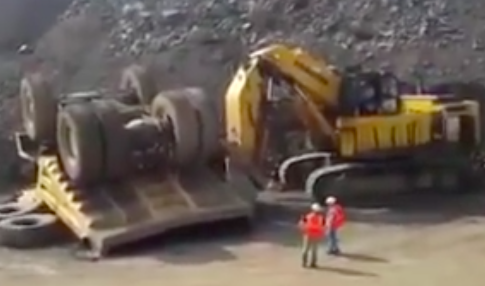 Watch These Miners Put A Massive Dump Truck Back On Its Wheels In Amazingly Gentle Fashion – 100% BS Approved!