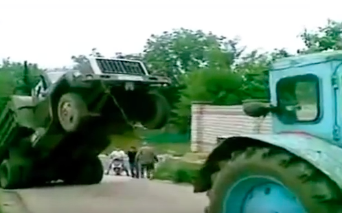 When A Tractor Attempts To Help A Truck In Russia, Always Expect The Unexpected