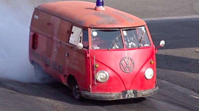 Nitrous Rules! Watch The Fire Bus Run 11s With The Driver Spraying And Shifting