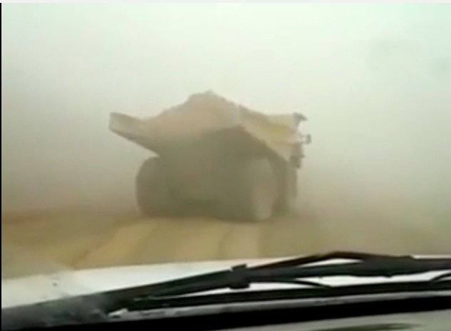 Pucker Up! Watch This Massive and Loaded Mining Haul Truck Spin Out On A Slippery Road