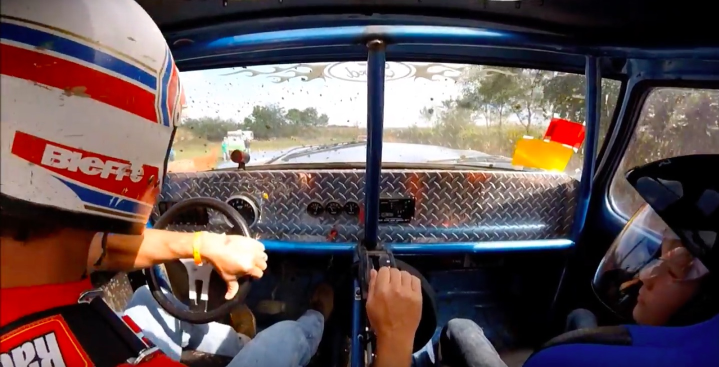Watch This Guy Take His Kid Through The Mud Bog Pit In His Mega-Truck!