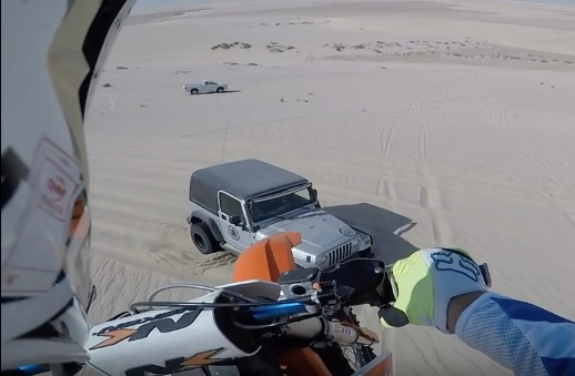 Look Before You Leap: This Dune Rider Went From A Hundred-Foot Jump Onto The Hood Of A Jeep!