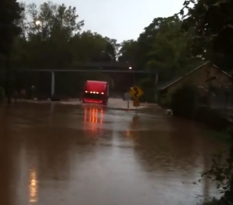 Calculated Risk Or The Luckiest Trucker In America? Watch This Rig Plow Through Water Up To Its Windshield!