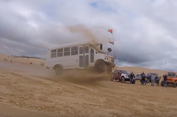 Some Days, You Just Need To Go Jump Some Sand Dunes In A Cheap Short Bus!