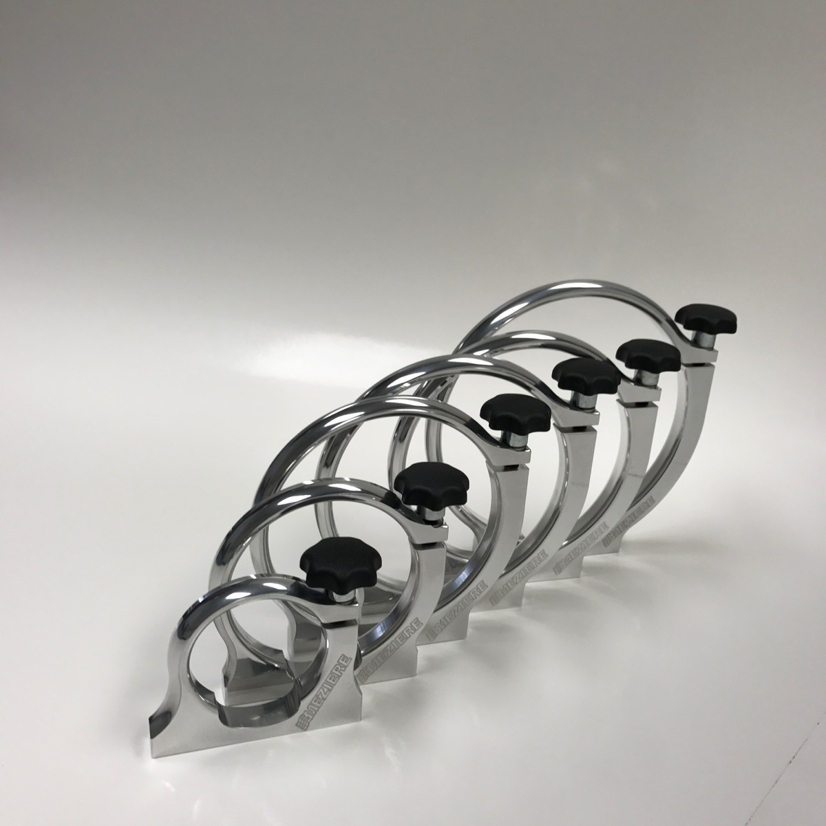 Meziere Enterprises Releases Killer New Bottle Clamps For Variety Of Racing Applications