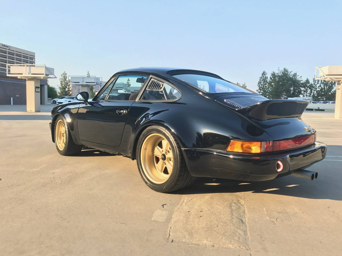 Bangshift this 1984 porsche 911 carrera wide body rs tribute this 1984 porsche 911 carrera wide body rs tribute is spectacular in black and gold sciox Image collections