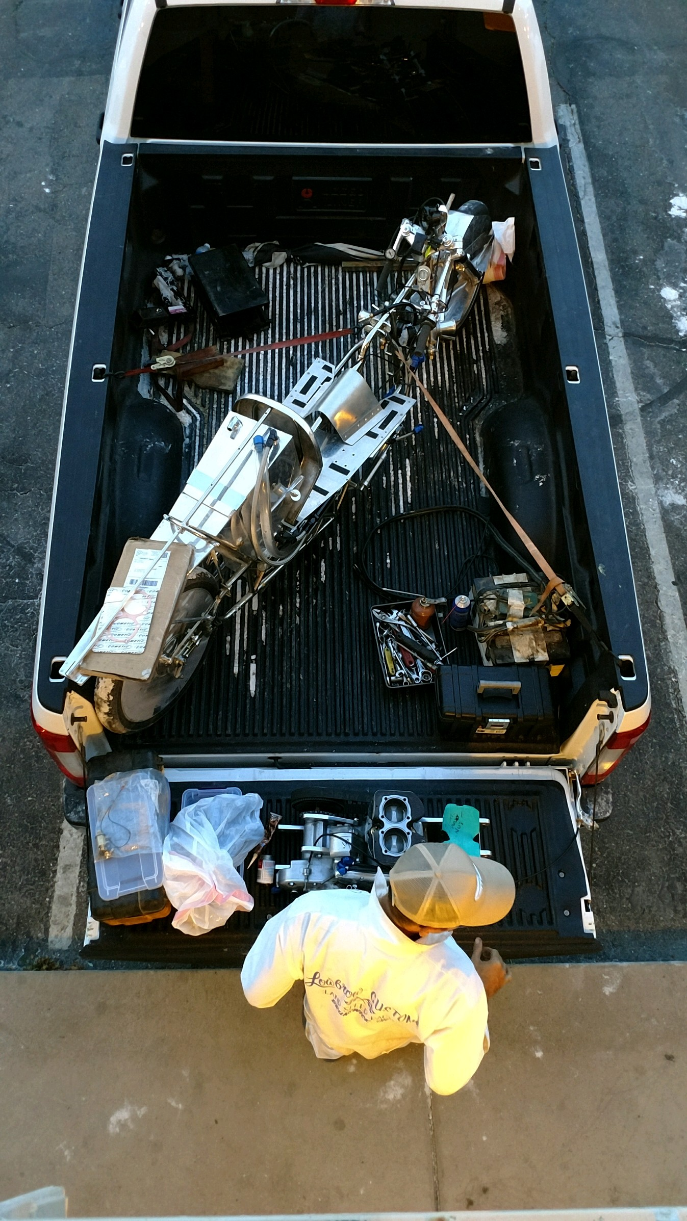 This Is Bonneville: Rebuilding An Amazing Motorcycle In The Bed Of A Truck Sitting In Front Of A Motel 6 Hotel Room