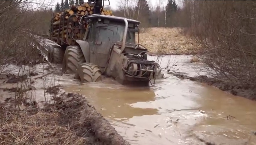 Dream Job? This Dude Gets Paid To Go Mud Bogging Every Day In A Tough Tractor
