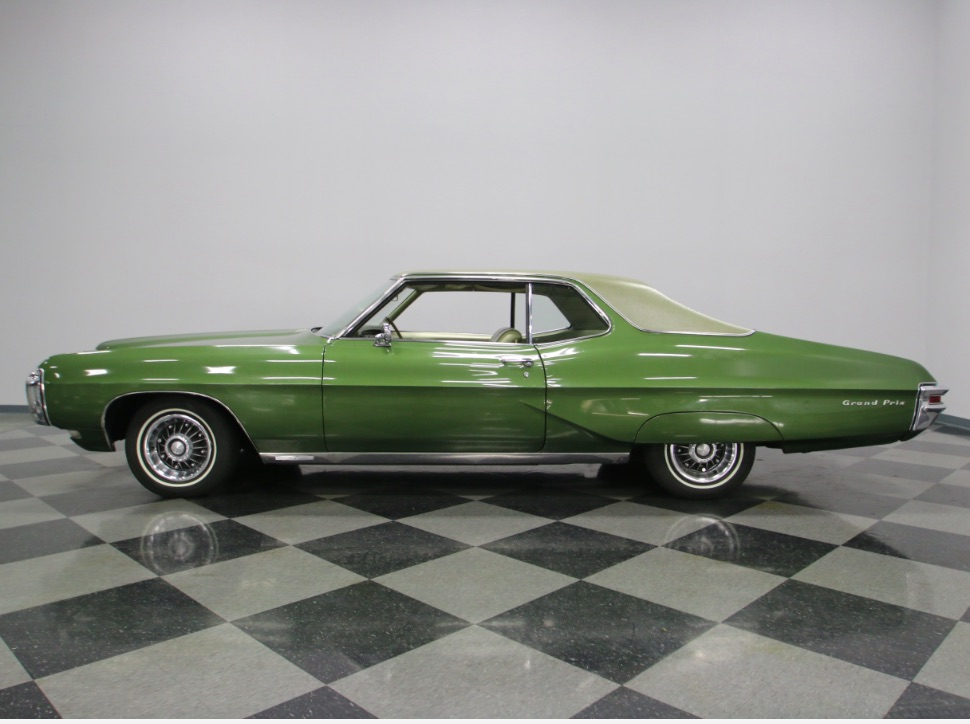 This 1968 Pontiac Grand Prix Is A Beatiful Oddball – Green With A Gold Roof And Interior?!