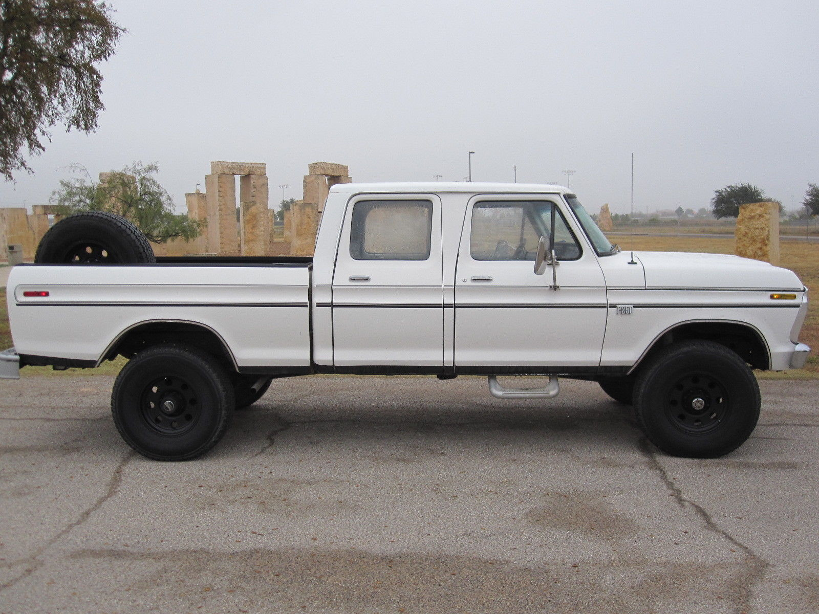 This 1976 ford f 250 crew cab is a little rough around the roof but